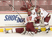 Emily Field (BC - 15), Blake Bolden (BC - 10), Alex Carpenter (BC - 5) and Allison Szlosek (BC - 8) celebrate Carpenter's shorthanded goal which opened scoring in the game late in the first period. - The Boston College Eagles defeated the visiting St. Lawrence University Saints 6-3 (EN) in their NCAA Quarterfinal match on Saturday, March 10, 2012, at Kelley Rink in Conte Forum in Chestnut Hill, Massachusetts.