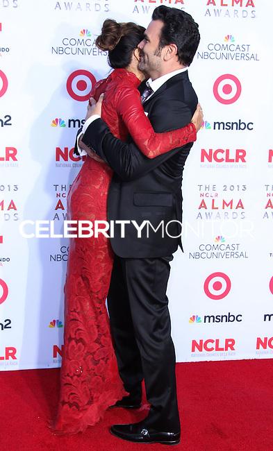PASADENA, CA - SEPTEMBER 27: Actress Eva Longoria and Actor Ricardo Antonio Chavira arrive at the 2013 NCLR ALMA Awards held at Pasadena Civic Auditorium on September 27, 2013 in Pasadena, California. (Photo by Xavier Collin/Celebrity Monitor)