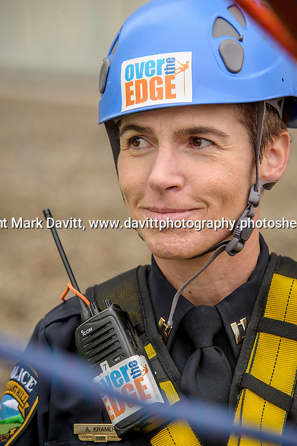 Captain Kramer offers a tentative smile as she listens to instruction from the rappel instructors.