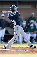 Catcher Ryan Kilgallen (13) of the Citadel bats in a game against the University of South Carolina Upstate Spartans on Tuesday, February, 18, 2014, at Cleveland S. Harley Park in Spartanburg, South Carolina. Upstate won, 6-2. (Tom Priddy/Four Seam Images)