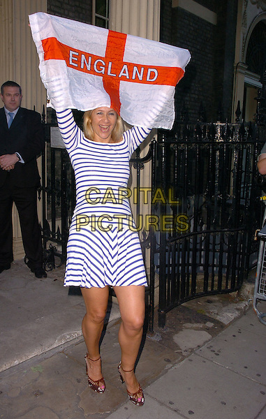 TANIA BRYER.Michele Watches Summer Party at Home House .15th June 2006 London, England. .Ref: CAN.full length horizontal stripes striped dress holding england flag .www.capitalpictures.com.sales@capitalpictures.com.©Can Nguyen/Capital Pictures