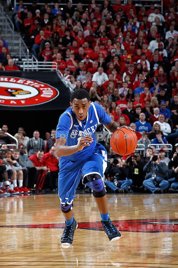 LOUISVILLE, KY - DECEMBER 29: Ryan Harrow #12 of the Kentucky Wildcats handles the ball against the Louisville Cardinals during the game at KFC Yum! Center on December 29, 2012 in Louisville, Kentucky. Louisville won 80-77. Ryan Harrow