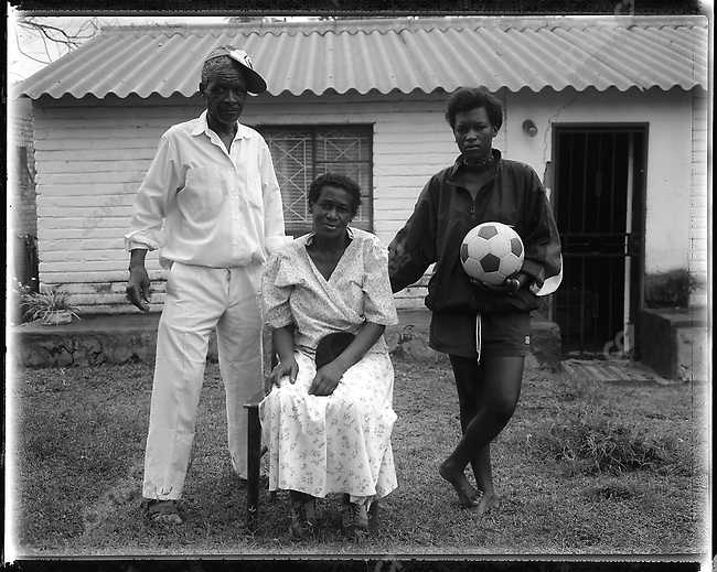 "Thembisa ""Portia"" Mtokwana (23), with her parents, Gunguletu Township, Cape Town, South Africa, 1998"