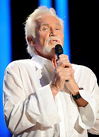 """20 March 2020 - Kenny Rogers, whose legendary music career spanned nearly six decades, has died at the age of 81. Rogers was inducted to the Country Music Hall of Fame in 2013."""" He had 24 No. 1 hits and through his career more than 50 million albums sold in the US alone. He was a six-time Country Music Awards winner and three-time Grammy Award winner. Some of his hits included """"Lady,"""" """"Lucille,"""" """"We've Got Tonight,"""" """"Islands In The Stream,"""" and """"Through the Years."""" His 1978 song """"The Gambler"""" inspired multiple TV movies, with Rogers as the main character. File Photo: 07 June 2008 - Nashville, Tennessee - Kenny Rogers. 2008 CMA Music Festival Nightly Concert held on Vault Concert Stage at LP Field. Photo Credit: Laura Farr/AdMedia"""