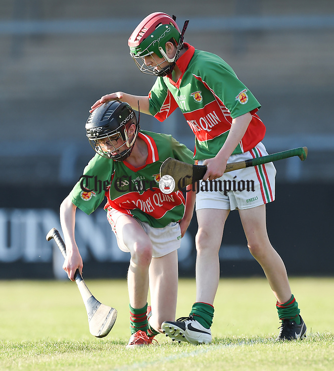 Shane Harrison of Clooney-Quin is congratulated on his first goal by team mate Eoin Guilfoyle during their U-14A final in Cusack Park. Photograph by John Kelly.