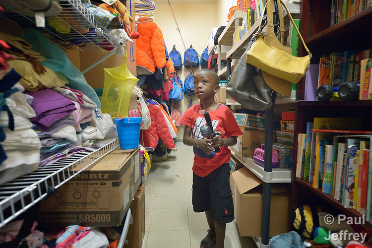 David Kalamba, a 6-year old resettled refugee from the Democratic Republic of the Congo, explores a supply room in the office of Church World Service in Lancaster, Pennsylvania. Church World Service resettles refugees in Pennsylvania and other locations in the United States. <br /> <br /> Photo by Paul Jeffrey for Church World Service.