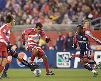 FC Dallas forward/midfielder David Ferreira (10) dribbles as New England Revolution midfielder/defender Jeff Larentowicz (13) and New England Revolution forward Kheli Dube (11) defend. The New England Revolution defeated FC Dallas, 2-1, at Gillette Stadium on April 4, 2009. Photo by Andrew Katsampes /isiphotos.com