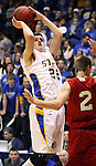 BROOKINGS, SD - JANUARY 12: Zach Monaghan #22 from South Dakota State University looks for the jumper over Jordan Boots #2 from University of South Dakota in the second half Thursday night at Frost Arena in Brookings. (Photo by Dave Eggen/Inertia)