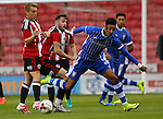 Louis Reed and Ben Whiteman of Sheffield Utd dispossess Sean Clare of Sheffield Wednesday during the U23 Professional Development League match at Bramall Lane Stadium, Sheffield. Picture date: September 6th, 2016. Pic Simon Bellis/Sportimage