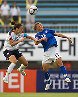 USWNT defender (15) Kate Markgraf goes up for a header against Italy's (11) Silvia Fuselli during the last group stage game at the Peace Queen Cup.  The USWNT defeated Italy, 2-0, at the Suwon Sports Center in Suwon, South Korea.