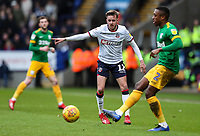 Bolton Wanderers' Craig Noone looks on as Preston North End's Darnell Fisher offloads the ball <br /> <br /> Photographer Andrew Kearns/CameraSport<br /> <br /> The EFL Sky Bet Championship - Bolton Wanderers v Preston North End - Saturday 9th February 2019 - University of Bolton Stadium - Bolton<br /> <br /> World Copyright © 2019 CameraSport. All rights reserved. 43 Linden Ave. Countesthorpe. Leicester. England. LE8 5PG - Tel: +44 (0) 116 277 4147 - admin@camerasport.com - www.camerasport.com