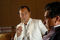 Denis Dubourdieu talks with M.Tasaki, the World Champion Sommelier in Tokyo, Japan. Mr  Dubourdieu was in Japan to promote a new Japanese wine that he is helping to create.