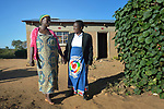 Misuzi Tembo (left) gets a home visit from midwife Tamala Chirwa in Kayeleka Banda, Malawi. Pregnant with her first child, Tembo receives support from the Maternal, Newborn and Child Health program of the Livingstonia Synod of the Church of Central Africa Presbyterian. Tembo's husband has a job in South Africa and sends home money to support her.
