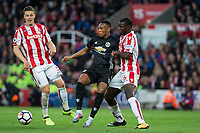 Anthony Martial of Man Utd holds off Kurt Zouma (6) of Stoke City & Kevin Wimmer of Stoke City during the Premier League match between Stoke City and Manchester United at the Britannia Stadium, Stoke-on-Trent, England on 9 September 2017. Photo by Andy Rowland.