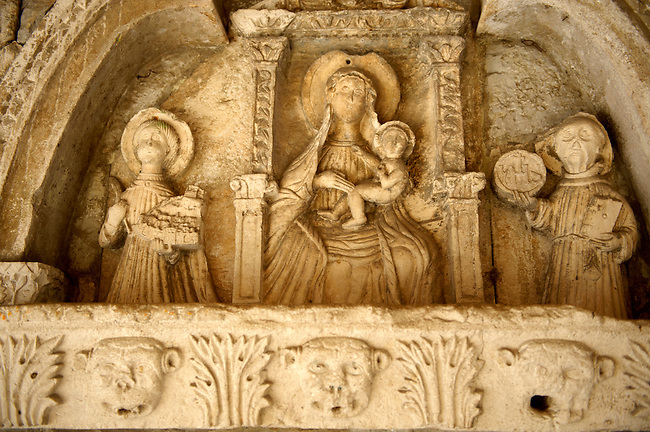 15th century Gothic bas relief of Virgin Mary center, Saint Tripun right, Saint Bernard left. Main gates, Kotor, Montenegro