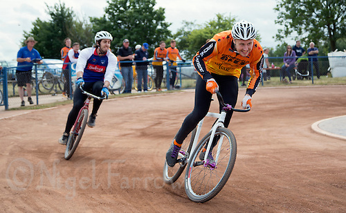 12 JUL 2015 - IPSWICH, GBR - Ben Mould of Wednesfield Aces races for the finish line after passing Josh Brooke of Ipswich Eagles on the last bend during the Elite League cycle speedway fixture at Whitton Sports and Community Centre in Ipswich, Suffolk, Great Britain (PHOTO COPYRIGHT © 2015 NIGEL FARROW, ALL RIGHTS RESERVED)