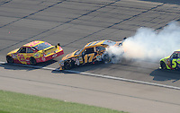 Sept. 28, 2008; Kansas City, KS, USA; Nascar Sprint Cup Series driver Matt Kenseth (17) gets turned sideways after contact with Casey Mears (5) during the Camping World RV 400 at Kansas Speedway. Mandatory Credit: Mark J. Rebilas-