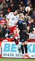 Michael Bostwick of Stevenage and Mike Grella of Bury challenge for a header. - Stevenage v Bury - npower League 1 - Lamex Stadium, Stevenage  - 5th May, 2012. © Kevin Coleman 2012