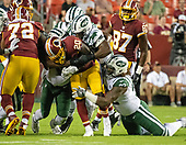 Washington Redskins running back Rob Kelley (20) is tackled by four New York Jets defensive players including defensive tackle Leonard Williams (92) and linebacker Jordan Jenkins (48) in first quarter action at FedEx Field in Landover, Maryland on Thursday, August 16, 2018.<br /> Credit: Ron Sachs / CNP<br /> (RESTRICTION: NO New York or New Jersey Newspapers or newspapers within a 75 mile radius of New York City)