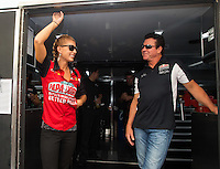 Oct 15, 2016; Ennis, TX, USA; NHRA top fuel driver Leah Pritchett (left) with Papa Johns Pizza owner John Schnatter during qualifying for the Fall Nationals at Texas Motorplex. Mandatory Credit: Mark J. Rebilas-USA TODAY Sports