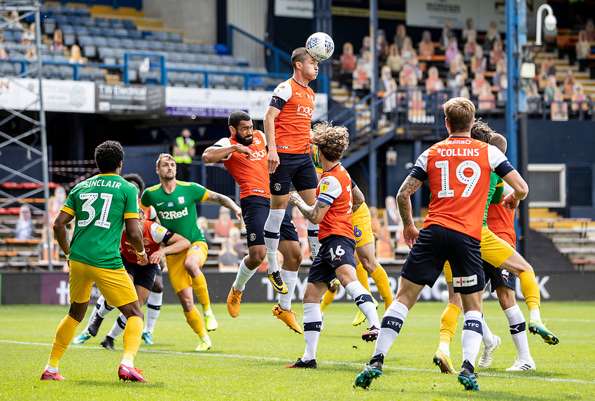 Luton Town's Dan Potts (centre) clears a Preston North End corner<br /> <br /> Photographer Andrew Kearns/CameraSport<br /> <br /> The EFL Sky Bet Championship - Luton Town v Preston North End - Saturday 20th June 2020 - Kenilworth Road - Luton<br /> <br /> World Copyright © 2020 CameraSport. All rights reserved. 43 Linden Ave. Countesthorpe. Leicester. England. LE8 5PG - Tel: +44 (0) 116 277 4147 - admin@camerasport.com - www.camerasport.com