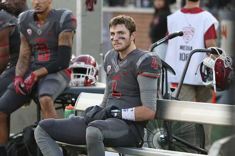 Luke Falk, Washington State University quarterback, takes a break while the defense is on the field during the Cougars non-conference game against the Wyoming Cowboys at Martin Stadium in Pullman, Washington, on September 19, 2015.  The Cougs used a dominating final three quarters to put away the Cowboys, 31-14.