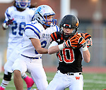 SIOUX FALLS, SD - OCTOBER 16:  Josh Garry #30 from Washington slides in front of intended receiver Cade Ellis #3 from Rapid City Stevens for the interception in the first half of their game Friday night at Howard Wood Field. (Photo by Dave Eggen/Inertia)