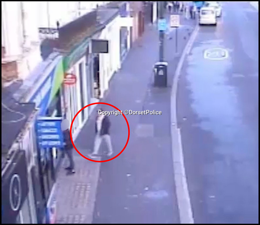 BNPS.co.uk (01202 558833)Pic: DorsetPolice/BNPS<br /> <br /> A screenshot of CCTV footage showing Kevin Boyle seconds before carrying out the attack on Glen Morrant at around 6:25am on Friday 18th August 2017.<br /> <br /> Boyle mistakes Glen Morrant as one of the bystanders 2 hours earlier on in the evening.<br /> <br /> Circled in red is Kevin Boyle.<br /> <br /> A knife maniac who nearly killed an innocent bystander he mistook for someone he had a row with because both men had ginger hair was today jailed for 21 years.<br /> <br /> Kevin Boyle waited outside a Bournemouth nightclub for the red-headed reveller who had shoved him two hours earlier to appear.<br /> <br /> When clubber Glen Morrant walked out Boyle began to follow him by mistake because he was wearing similar clothes to the first man and also had ginger hair.<br /> <br /> Boyle slashed the 19-year-old by the throat. He was sentenced today at Winchester Crown Court.