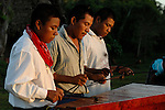 Three men play one harpsichord in their remote Mayan village in southern Belize.