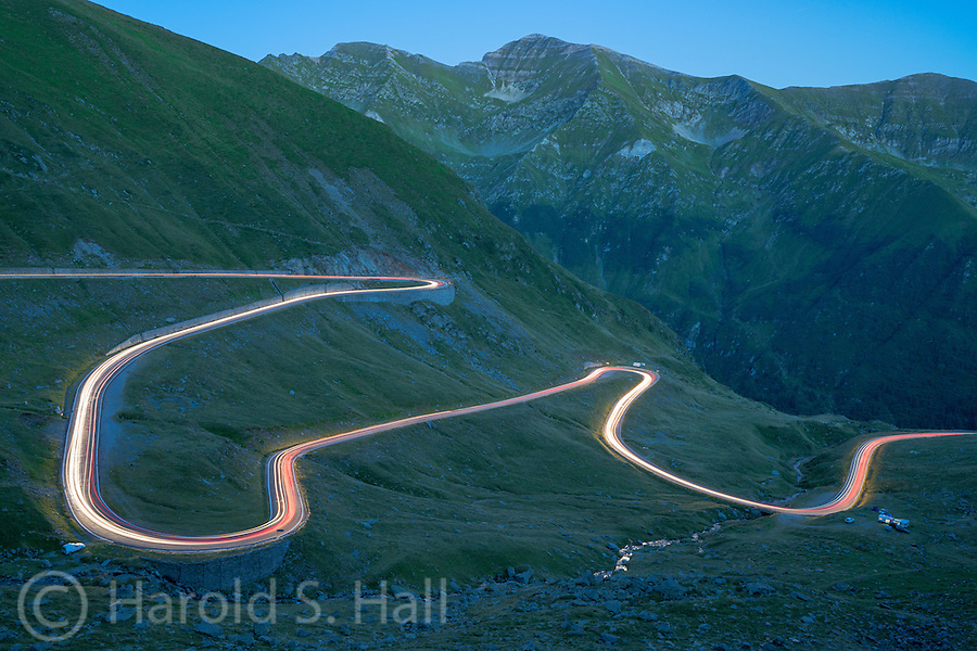 This mountainous highway was popularized by a British TV show which named it the 'Best Road in the World'. It is another project built by Nicolae Ceausescu, completed in 1974.  The stream in the lower right is illuminated by a full moon.