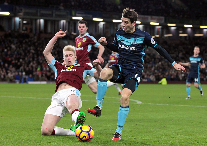 Middlesbrough's Marten de Roon is tackled by Burnley's Ben Mee<br /> <br /> Photographer Rich Linley/CameraSport<br /> <br /> The Premier League - Burnley v Middlesbrough - Monday 26th December 2016 - Turf Moor - Burnley<br /> <br /> World Copyright &copy; 2016 CameraSport. All rights reserved. 43 Linden Ave. Countesthorpe. Leicester. England. LE8 5PG - Tel: +44 (0) 116 277 4147 - admin@camerasport.com - www.camerasport.com