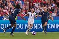 PARIS,  - JUNE 28: Wendie Renard #3 defends Rose Lavelle #16 as she moves past Eugénie Le Sommer #9 during a game between France and USWNT at Parc des Princes on June 28, 2019 in Paris, France.