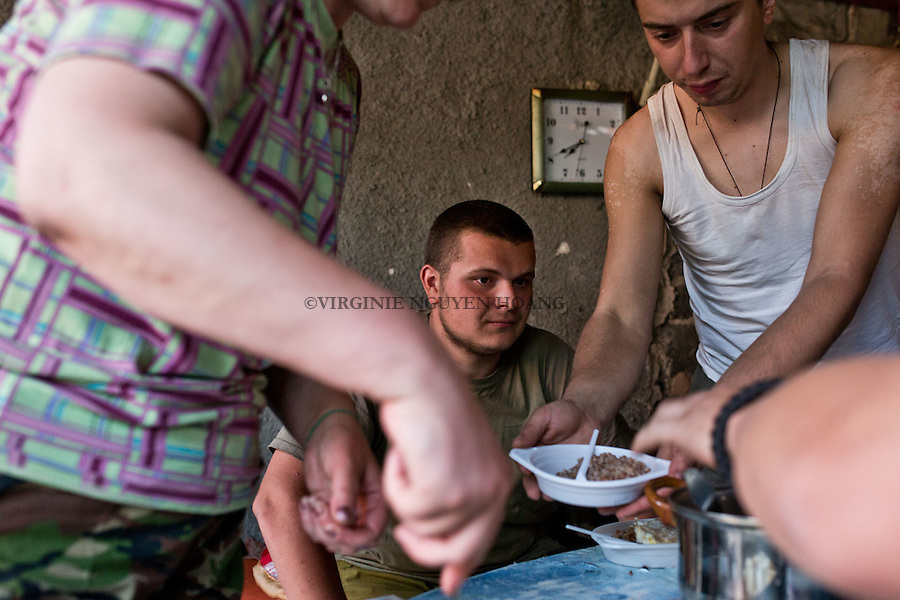 UKRAINE, Pisky: After and before his shift Daniel spend some time with his comrades and the &quot;Mama&quot;, the medic of the base. He likes to stay there and think about something else than the war. <br />