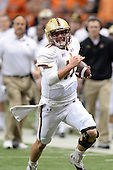 Boston College Eagles quarterback Chase Rettig (11) runs up field during a game against the Syracuse Orange at the Carrier Dome on November 30, 2013 in Syracuse, New York.  Syracuse defeated Boston College 34-31.  (Copyright Mike Janes Photography)