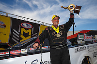 Feb 28, 2016; Chandler, AZ, USA; NHRA funny car driver Tim Wilkerson celebrates after winning the Carquest Nationals at Wild Horse Pass Motorsports Park. Mandatory Credit: Mark J. Rebilas-