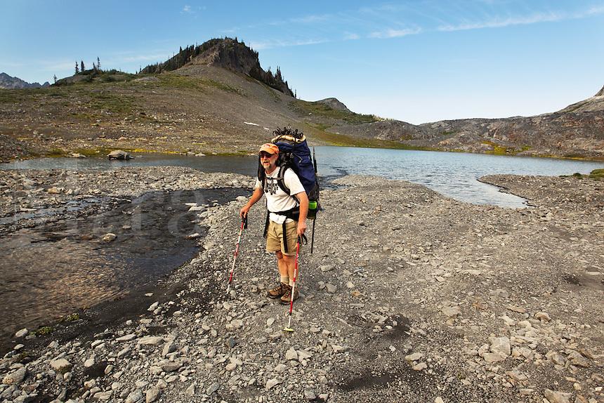 Backpacker in Ferry Basin, Bailey Range Traverse, Olympic National Park, Washington