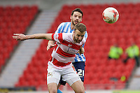 Doncaster Rovers v Coventry City, 23.4.2016<br /> Sky Bet League One<br /> Picture Shaun Flannery/Trevor Smith Photography<br /> Rovers Andy Williams holds off Coventry's Aaron Martin.