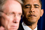 Senate Majority Leader Harry Reid (D-NV), left, and Sen. Barack Obama (D-IL) attend a press conference with other Senate Democratic leaders to highlight their new ethics reform package for the 110th Congress.