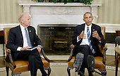 United States President Barack Obama speaks as US Vice President Joe Biden looks on while discussing the release of the Cancer Moonshot Report in the Oval Office of the White House on October 17, 2016 in Washington, DC.<br /> Credit: Olivier Douliery / Pool via CNP