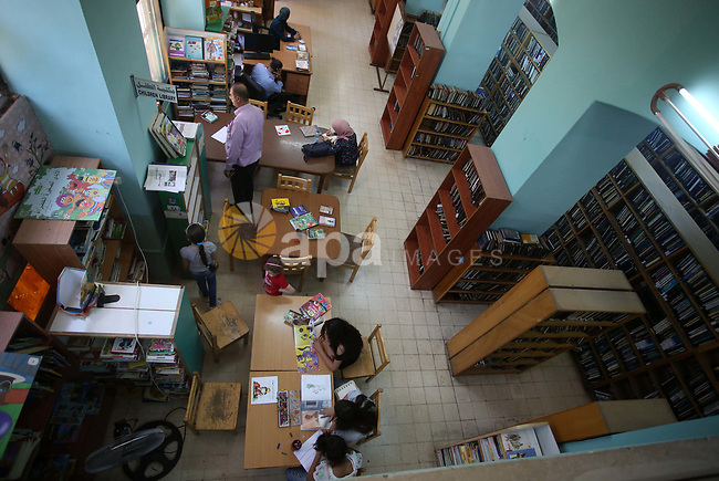 Palestinian students read books at Nablus public library in the West Bank city of Nablus, on August 6, 2017. Nablus public library, the largest, and the oldest, in all of Palestine, opened in 1960, and library includes approximately 80,000 books, the majority of which are in Arabic. Besides the circulating collection, Nablus Library also houses several significant archival collections, including the so-called Prisoner's Section, an archive of materials made and used by Palestinian prisoners held in Israeli jails between 1975 and 1995, as well as the personal collection of Qadri Tuqan, a Nablusi educator and one of the founders of An-Najah College, now An-Najah National University.Other collections include Palestinian newspapers dating back to the 1920s. Photo by Ayman Ameen