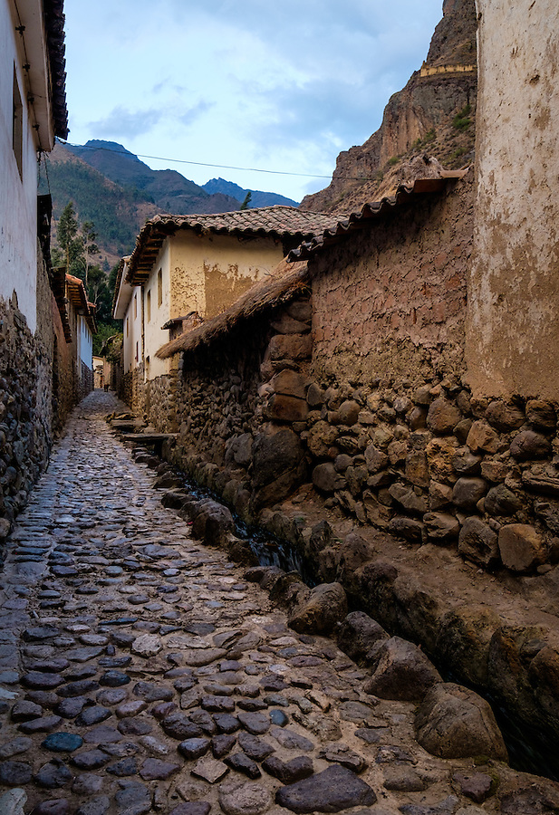 OLLANTAYTAMBO, PERU - CIRCA OCTOBER 2015:  Typical cobblestone street in Ollantaytambo, a small village in the Cusco region known as Sacred Valley
