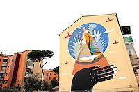 Titolo: The globe,  Artista Agostino Iacurci<br /> Title The globe, Artist Agostino Iacurci<br /> Il Mondo in una sfera natalizia<br /> The world in a Christmas ball<br /> Roma 17-11-2015 Street Art a Roma. In vari quartieri di Roma e' fiorita la Street Art, con splendidi murales che hanno lo scopo di raccontare delle storie della citta', di commemorare dei momenti importanti, o semplicemente di interpretarla.<br /> Street Art in Rome. Very important writers  painted Murales in various districts of Rome to tell stories about the city, to commemorate important moments, to embellish the quarter or simply to portray it.  <br /> Photo Samantha Zucchi Insidefoto