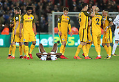 4th November 2017, Liberty Stadium, Swansea, Wales; EPL Premier League football, Swansea City versus Brighton and Hove Albion; Tammy Abraham of Swansea City lies dejected at the end of the game as Brighton celebrate around him
