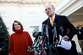 United States Senate Minority Leader Chuck Schumer (Democrat of New York) and US House Speaker-designate Nancy Pelosi (Democrat of California) talk to reporters outside the West Wing of the White House following a contentious meeting with President Donald Trump on shutting down the government over border security differences, in Washington, D.C., December 11, 2018.<br /> Credit: Martin H. Simon / CNP