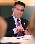 Gov. Brian Sandoval works in a Board of Examiners meeting in Carson City, Nev., on Tuesday, Feb. 10, 2015. <br /> Photo by Cathleen Allison