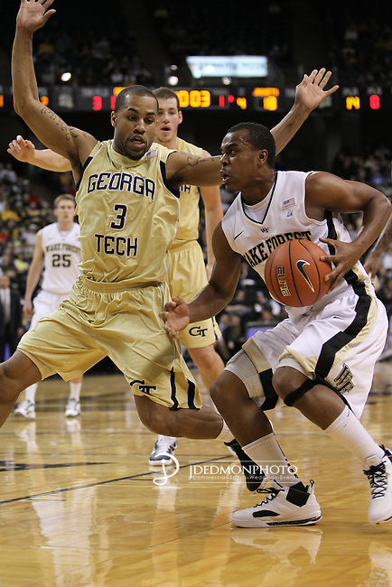 Wake Forest Demon Deacons guard Tony Chennault (1) drives the basket on Georgia Tech Yellow Jackets guard Maurice Miller (3). Georgia Tech leads at the half 35-28.