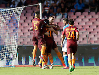 Calcio, Serie A: Napoli vs Roma. Napoli, stadio San Paolo, 15 ottobre. <br /> Roma Edin Dzeko, center, celebrates with teammates after scoring during the Italian Serie A football match between Napoli and Roma at Naples' San Paolo stadium, 15 October 2016. Roma won 3-1.<br /> UPDATE IMAGES PRESS/Isabella Bonotto