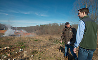 NWA Democrat-Gazette/BEN GOFF @NWABENGOFF<br /> Kevin White (left), associate director of land resources with the Arkansas Department of Environmental Quality, leads U.S. Sen. Tom Cotton and other guests on a tour Friday, Feb. 8, 2019, at the stump dump fire site in Bella Vista.