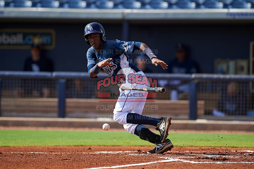 GCL Rays second baseman Joseph Astacio (7) lays down a bunt during the first game of a doubleheader against the GCL Red Sox on August 4, 2015 at Charlotte Sports Park in Port Charlotte, Florida.  GCL Red Sox defeated the GCL Rays 10-2.  (Mike Janes/Four Seam Images)