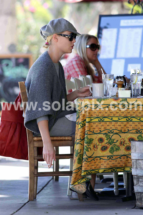 **ALL ROUND EXCLUSIVE PICTURES FROM SOLARPIX.COM**.**WORLDWIDE SYNDICATION RIGHTS**.**NO PUBLICATION IN AUSTRALIA, NEW ZEALAND,.DENMARK, GERMANY OR USA**.Katherine Heigl and her husband Josh Kelly have a smoking breakfast on the patio of Cafe Du Village in Los Angeles, where Katherine enjoys staring off the day by smoking a few cigarettes with breakfast. Los Angeles, California, USA. 12th November 2008..This pic: Katherine Heigl..JOB REF: 7869 LAP (MDAS)  DATE: 12_11_2008 .**MUST CREDIT SOLARPIX.COM OR DOUBLE FEE WILL BE CHARGED* *UNDER NO CIRCUMSTANCES IS THIS IMAGE TO BE REPRODUCED FOR ANY ONLINE EDITION WITHOUT PRIOR PERMISSION*